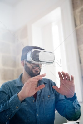 Man with his hands in front of his face