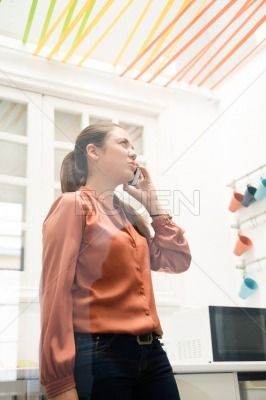 Woman looking up and talking on her phone