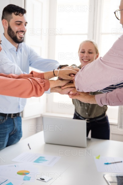 Business team celebrating a win in an office