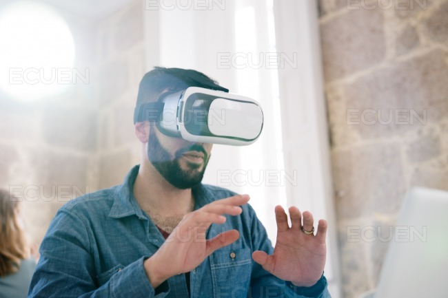 Man testing virtual reality glasses with hands up stock photo