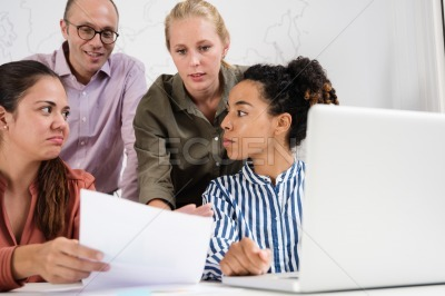Business team in a meeting discussing a document