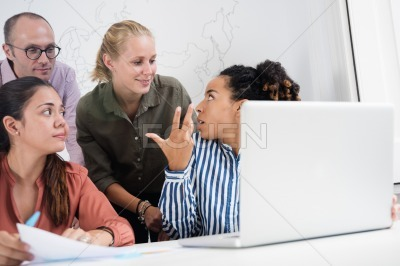 Business team talking and discussing in an office