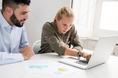 Business team working and typing of a laptop