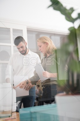 Couple standing in an office using a copier