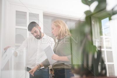Man and woman in an office using a photocopier