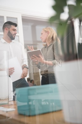 Woman and man talking in an office