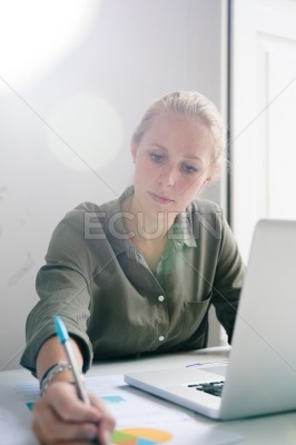 Woman working on documents in an office