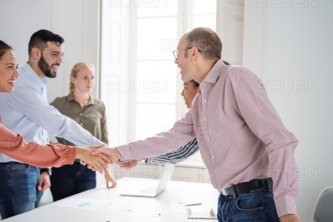 Business team shaking hands in an office stock photo