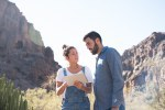 Man and woman standing next to cactus