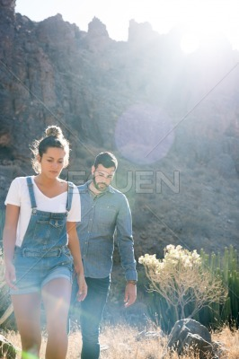 Couple hiking in the mountains on a sunny day