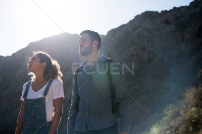 Man and woman in the desert looking up