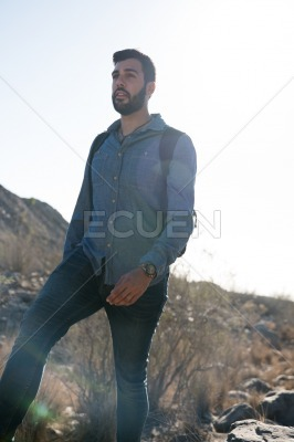 Man standing on a path with tall grass
