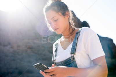Woman looks down at her cell phone