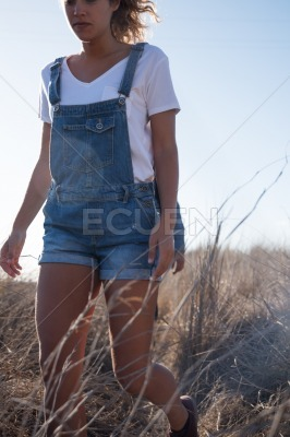 Woman walking on a grassy plain