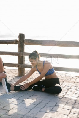 Woman stretching her legs as she exercises