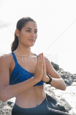 Woman doing a namaste yoga pose