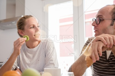 Couple sitting and talking at a kitchen table