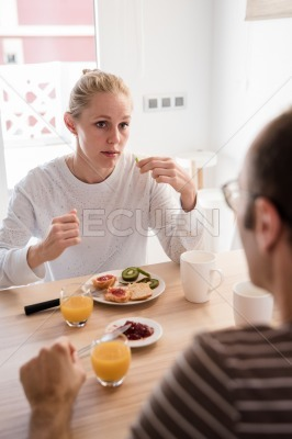Couple sitting at a table and talking