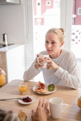 Woman sitting at a table eating