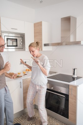Couple dancing together in a kitchen
