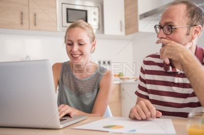 Couple sitting at a table in a kitchen