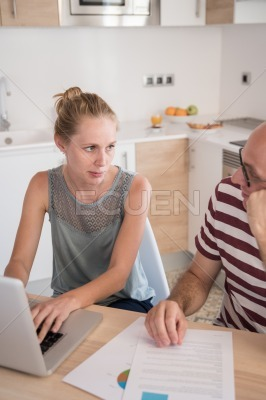 Woman looking at a man as they sit at a table