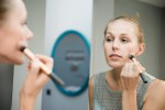 Woman looking intently at a mirror