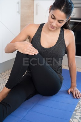 Woman crossing her leg over her knee in exercise