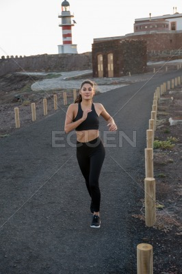 Close up of a woman running on a a road