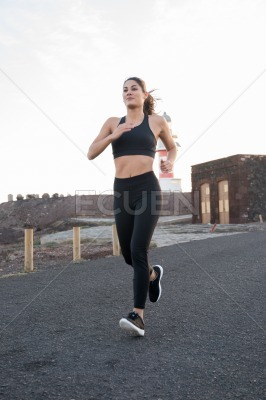 Woman has her arks akimbo as she runs