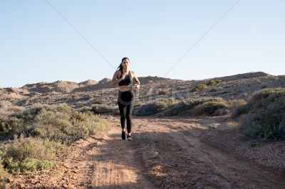 Woman running in the desert on a sunnyday