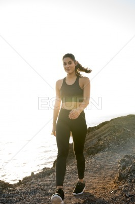 Woman with a ponytail blowing in the wind