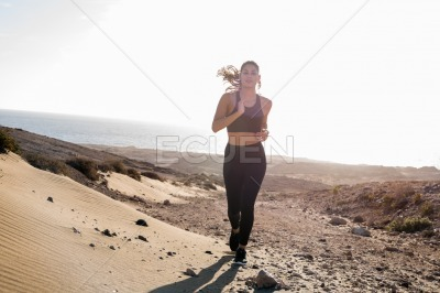 Close up of a woman running in the desert
