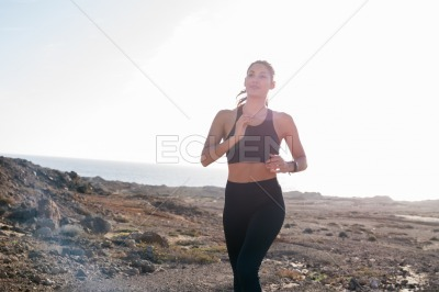 From waist view of a woman running