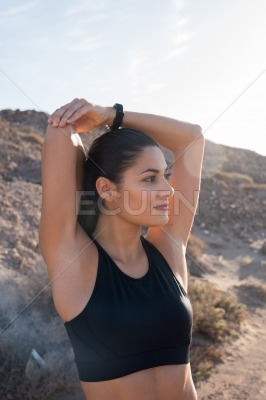 Woman stretching her arms and looking away