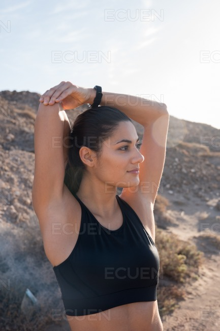 Woman stretching her arms and looking away stock photo