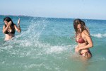 Two girls splashing and laughing in the sea