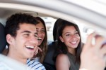 Young people in a car taking a photo