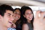 Young people in a car taking a selfie