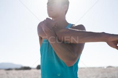 Close up of a man stretching his arm