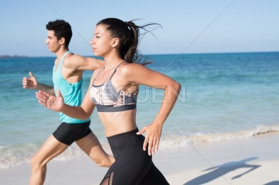 Close up of girl and boy running