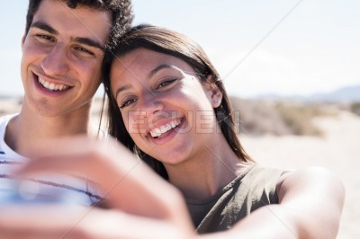 Close up of young couple smiling at the camera