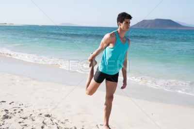Man holds his leg behind him as he exercises