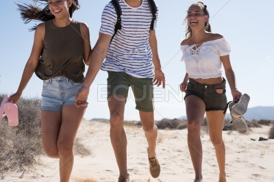 Three young people having fun at the beach