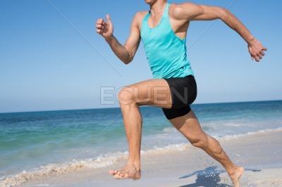 Torso shot of a muscular man running