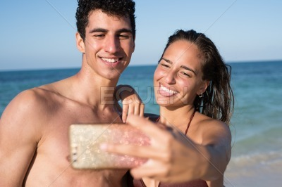 Young couple laughing and pulling a tongue