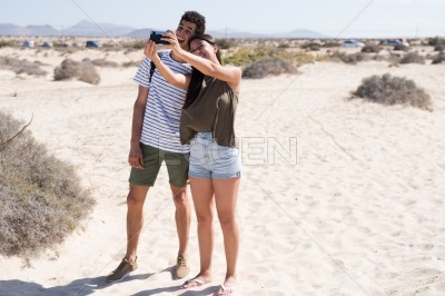 Young couple taking a selfie on the beach