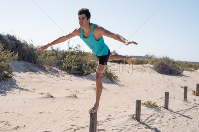 Young man leaning forward as he balances