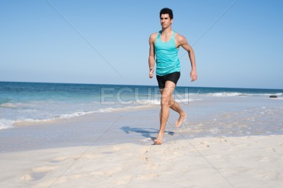 Young man running with his arms at his sides