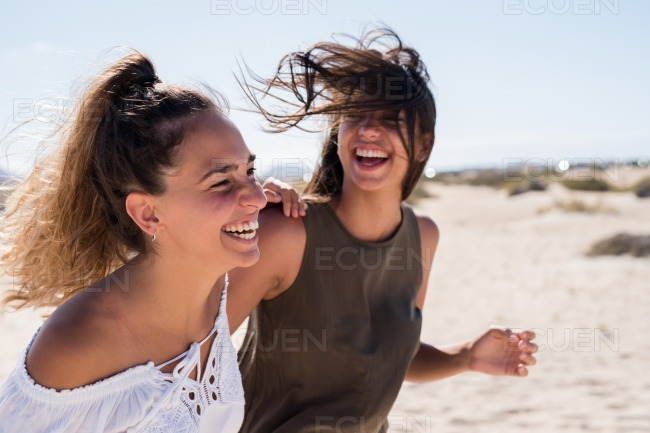 Wind blowing the young girls hair as she laughs stock photo